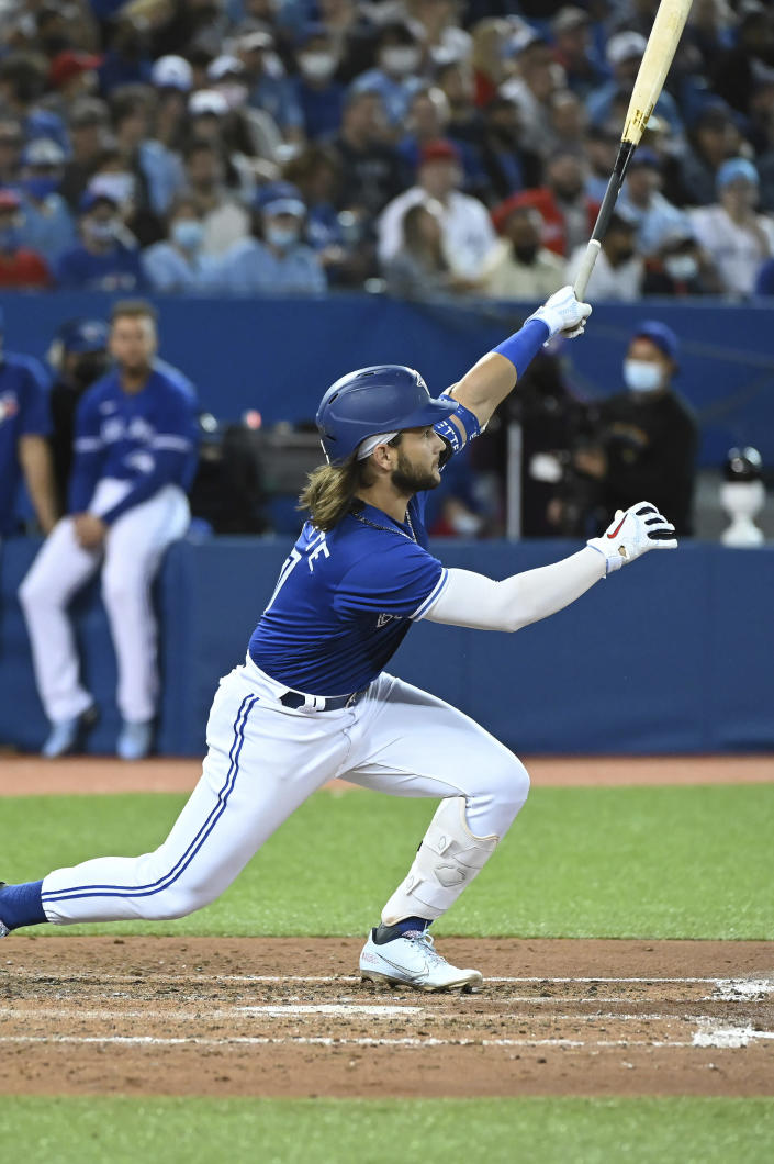 Toronto Blue Jays' Bo Bichette watches his solo home run in the fifth inning of a baseball game against the Tampa Bay Rays in Toronto on Monday, Sept. 13, 2021. (Jon Blacker/The Canadian Press via AP)