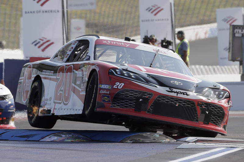 Christopher Bell (20) navigates Turn 12 during the NASCAR Xfinity Series auto race at Charlotte Motor Speedway in Concord, N.C., Saturday, Sept. 28, 2019. (AP Photo/Gerry Broome)