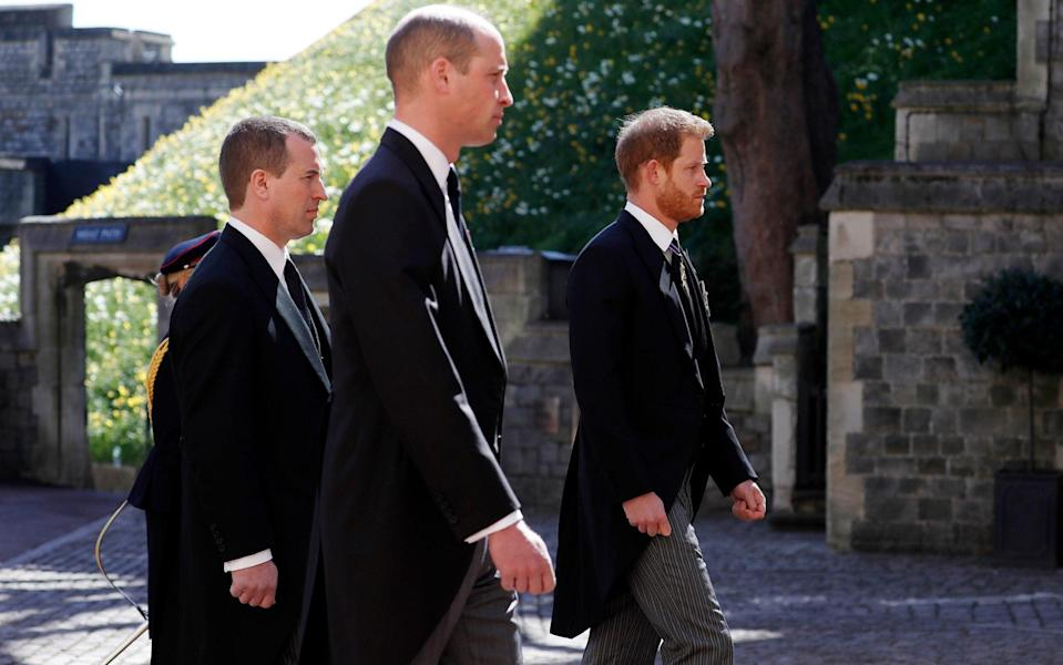 Peter Phillips walks between princes William and Harry at the Duke of Edinburgh's funeral in April - Alastair Grant/WPA Pool/Getty Images