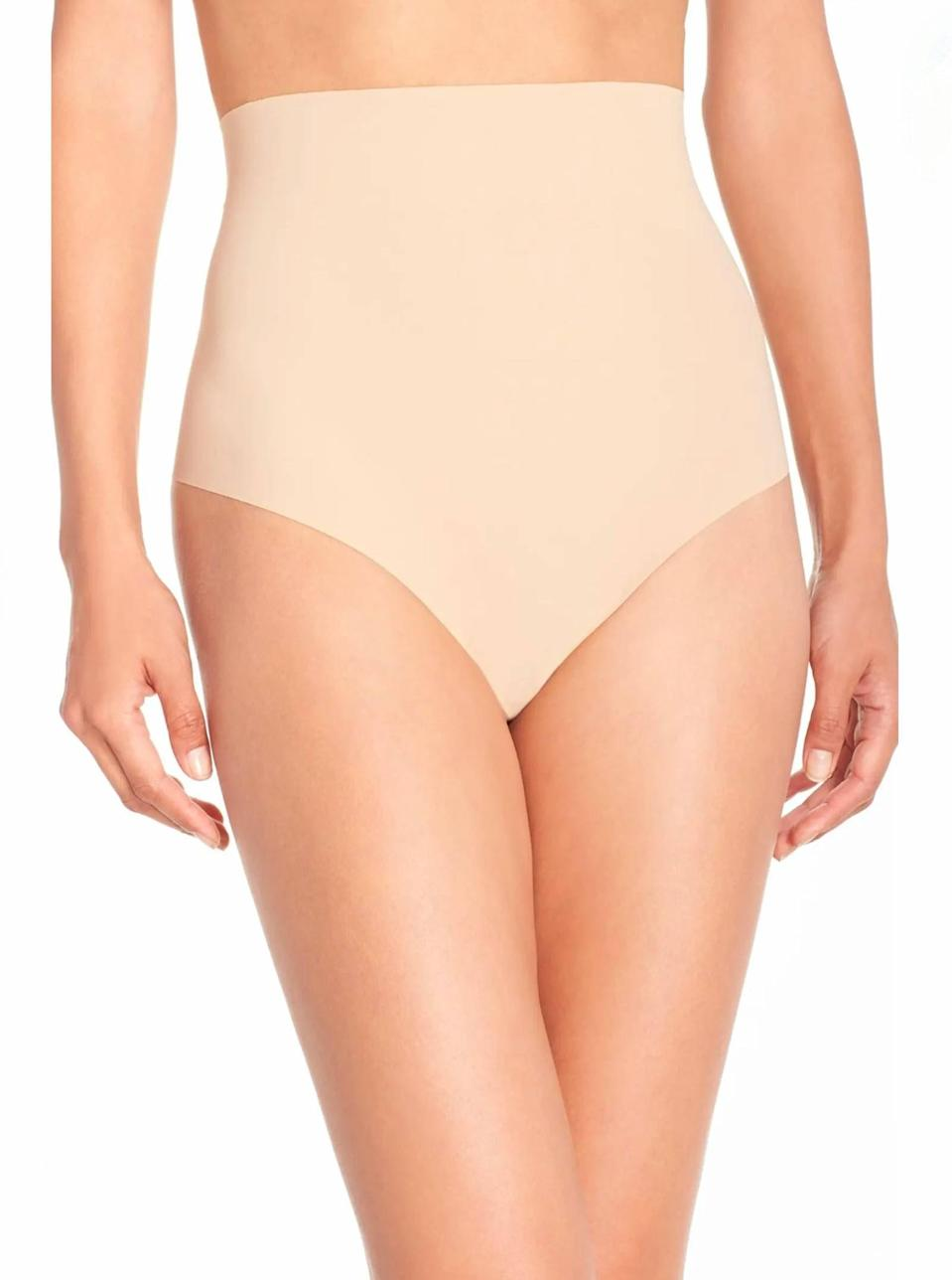 """Perfect for a bodycon moment, Commando's seamless thong hugs your hips and waist in all the right places. $38, Nordstrom. <a href=""""https://www.nordstrom.com/s/commando-control-top-thong/3322811"""" rel=""""nofollow noopener"""" target=""""_blank"""" data-ylk=""""slk:Get it now!"""" class=""""link rapid-noclick-resp"""">Get it now!</a>"""