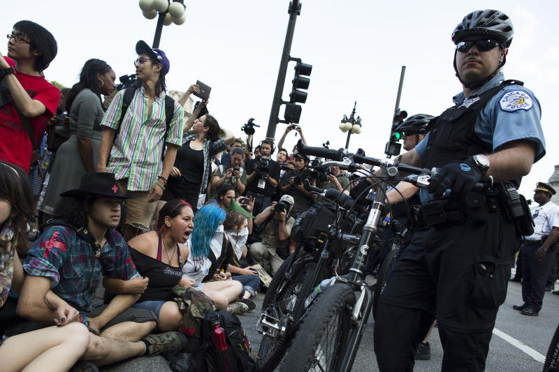 NATO protestors form a sit-in in response to a police barricade of bicycles, Saturday, May 19, 2012, in Chicago. Security has been high throughout the city in preparation for the NATO summit, where delegations from about 60 countries will discuss the war in Afghanistan and European missile defense. (AP Photo/John Minchillo)