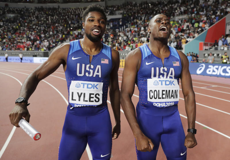 United States men's 4x100 relay gold winners Noah Lyles and Christian Coleman, right, celebrate at the World Athletics Championships in Doha, Qatar, Saturday, Oct. 5, 2019. (AP Photo/Hassan Ammar)