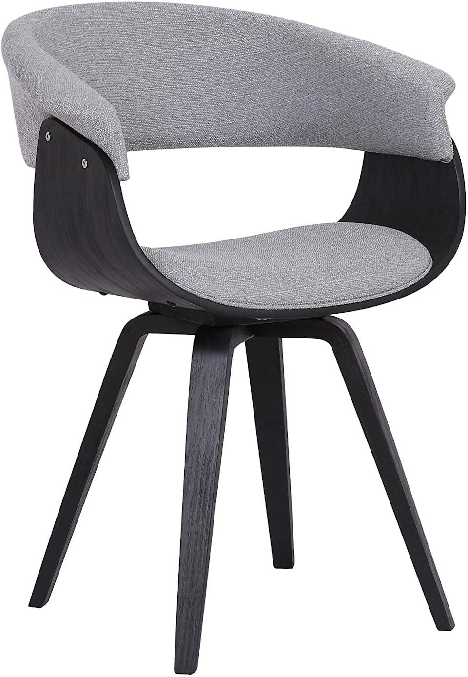 "<h2>Armen Living Summer Dining Chair</h2> <br><strong>Best For: Secret Desk Chair</strong><br>Wanna hear a secret? This ""dining chair"" is actually a rookie desk chair — built with a hidden swivel capability and sturdy bucket-seat design that is ready to support your WFH booty in MCM-style. <br><br><strong>The Hype: </strong>4.4 out of 5 stars and 383 reviews on <a href=""https://amzn.to/2z4Fd9y"" rel=""nofollow noopener"" target=""_blank"" data-ylk=""slk:Amazon"" class=""link rapid-noclick-resp"">Amazon</a><br><br><strong>Comfy Butts Say:</strong> ""This chair hit all the points for what I was looking for in setting up my office in this quarantine/work-from-home world: 1) it is stylish, 2) it arrived quickly, 3) it was so quick to put together, 4) it didn't break the bank, and 5) it's comfy and I have somewhere to rest my arms. Overall, I highly recommend especially if you find yourself creating an at-home office on a whim/budget.""<br><br><strong>Armen Living</strong> Summer Dining Chair, Gray, $, available at <a href=""https://amzn.to/3e5v7nY"" rel=""nofollow noopener"" target=""_blank"" data-ylk=""slk:Amazon"" class=""link rapid-noclick-resp"">Amazon</a><br><br><br><br><br><br>"
