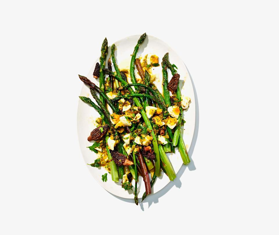 "You don't have to peel asparagus (unless you really want to!); just leave any thicker spears in the pan for an extra minute. That said, it's essential that you don't overcook the asparagus, because that's when it gets stringy and sad. <a href=""https://www.bonappetit.com/recipe/sauteed-asparagus-and-morels-with-gribiche-dressing?mbid=synd_yahoo_rss"" rel=""nofollow noopener"" target=""_blank"" data-ylk=""slk:See recipe."" class=""link rapid-noclick-resp"">See recipe.</a>"