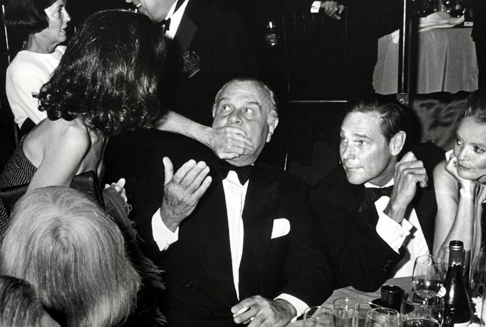 <p>Blass finds himself muffled during Saks Fifth Avenue's Salute to American Designers Gala in 1988.</p>