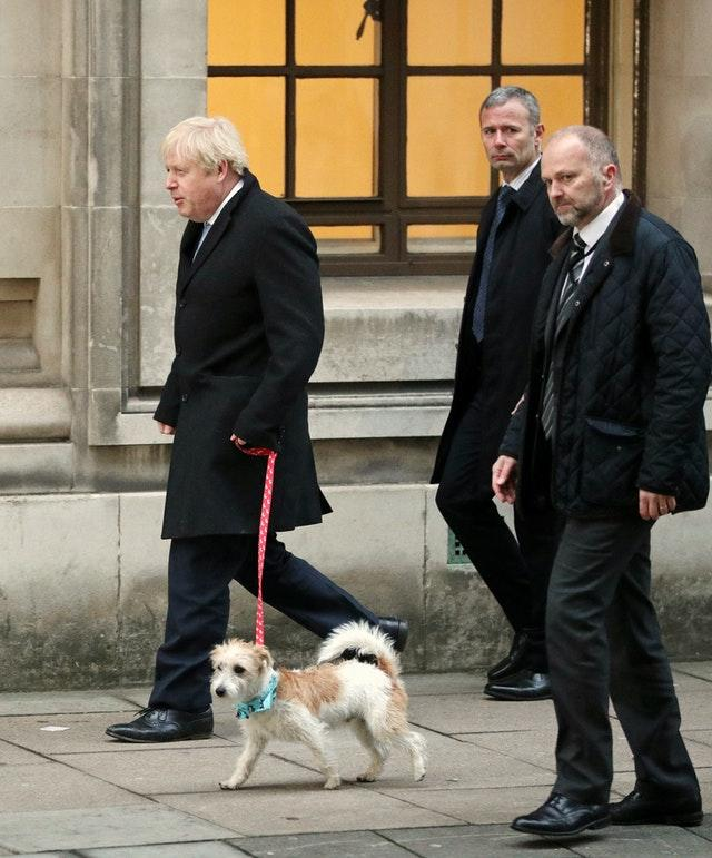 Prime Minister Boris Johnson with his dog, Dilyn (Jonathan Brady/PA)