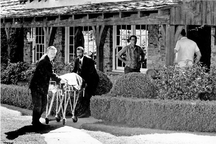FILE - This Aug. 9, 1969 file photo shows the body of actress Sharon Tate being taken from her rented house on Cielo Drive in the Bel-Air area of Los Angeles. , Calif. Tate, who was eight months pregnant, and four others were found murdered by American cult-leader Charles Manson and his followers. Fifty years ago Charles Manson dispatched a group of disaffected young followers on a two-night killing rampage that terrorized Los Angeles and, in the years since, has come to represent the face of evil. (AP Photo/File)
