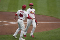 St. Louis Cardinals' Harrison Bader (48) congratulates teammate Edmundo Sosa (63) after Sosa scored during the second inning of a baseball game against the Pittsburgh Pirates Tuesday, May 18, 2021, in St. Louis. (AP Photo/Jeff Roberson)