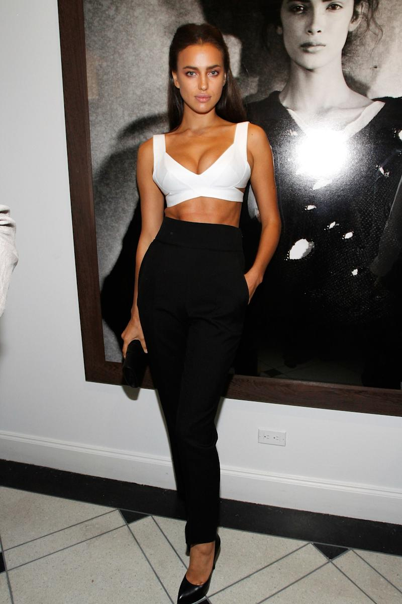 The model showed off her abs in a white bra-top and high-waisted black pants.