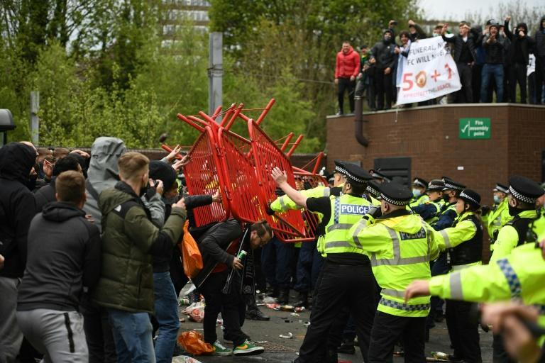 Scuffles broke out as police moved in to disperse Manchester United fans protesting outside Old Trafford