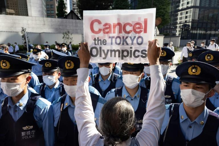 Protesters were blocked by police outside the IOC's executive board meeting