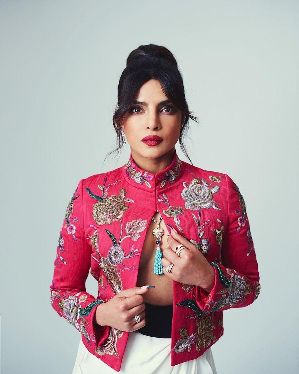 "<div class=""paragraphs""><p>Priyanka stuns in an embroidered red jacket with white harem pants.</p></div>"