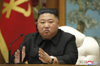 "In this photo provided by the North Korean government, North Korean leader Kim Jong Un attends a meeting of the ruling Workers' Party Politburo in Pyongyang, North Korea Tuesday, Dec. 29, 2020. Kim has reviewed the agenda for a ruling party congress set for early next month, state media reported Tuesday, dispelling outside speculation the North might delay the meeting due to the COVID-19 pandemic. Independent journalists were not given access to cover the event depicted in this image distributed by the North Korean government. The content of this image is as provided and cannot be independently verified. Korean language watermark on image as provided by source reads: ""KCNA"" which is the abbreviation for Korean Central News Agency.(Korean Central News Agency/Korea News Service via AP)"
