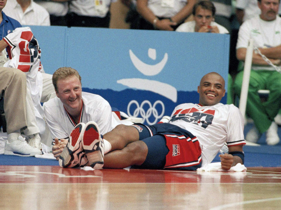 FILE - In this July 31, 1992, file photo, team USA's Larry Bird, left, and Charles Barkley relax on the sidelines toward the end of the a 127-83 win against Brazil at the Summer Olympics in Barcelona. (AP Photo/Susan Ragan, File)
