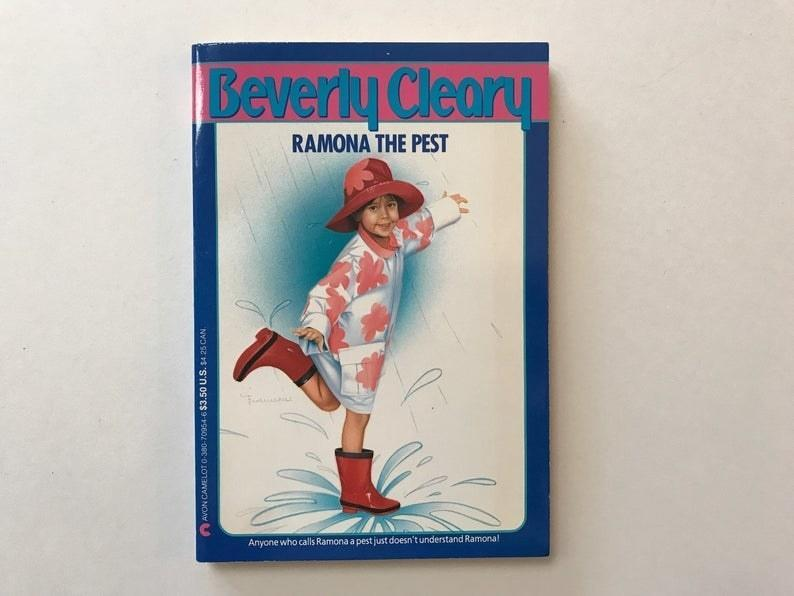 Ramona the Pest book cover from 1992 featuring a young girl splashing in a puddle