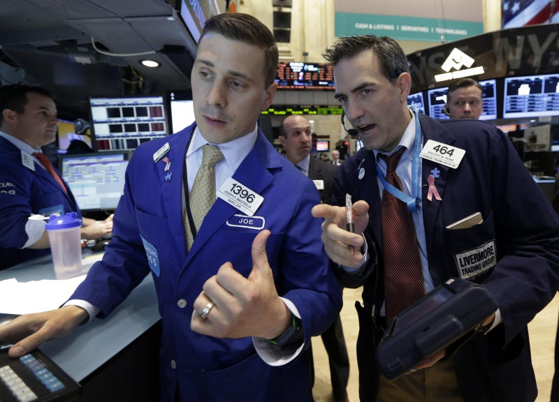 Specialist Joseph Mastrolia, left, and trader Gregory Rowe, work on the floor of the New York Stock Exchange Wednesday, April 24, 2013. Stock indexes are little changed in early trading on Wall Street following mixed earnings results from Apple, Ford, Boeing and other major U.S. companies. (AP Photo/Richard Drew)