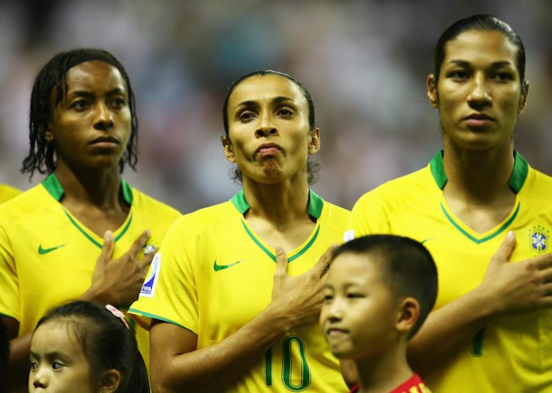SHANGHAI, CHINA - SEPTEMBER 30: Marta Vieira Da Silva of Brazil sings the national anthem alongside her team-mates prior to the start of the Women's World Cup 2007 Final between Brazil and Germany at Shanghai Hongkou Football Stadium on September 30, 2007 in Shanghai, China. (Photo by Paul Gilham/Getty Images)