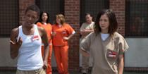 <p><strong>For Soso:</strong> A prison jumpsuit in a khaki color, a black, shoulder-length bobbed wig, and black slip-on sneakers.</p> <p><strong>For Poussey:</strong> Poussey's look is the same as Soso's, only she usually just wears a white tank top instead of the full khaki shirt, and she rocks a close-cropped haircut. If you want to go the extra mile, make little badges with the characters' names on them to stick on your pockets.</p>