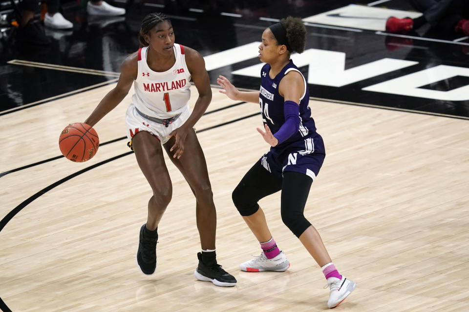 Maryland's Diamond Miller (1) is defended by Northwestern's Jordan Hamilton (24) during the second half of an NCAA college basketball semifinal game at the Big Ten Conference tournament, Friday, March 12, 2021, in Indianapolis. (AP Photo/Darron Cummings)