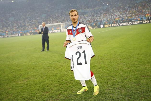 Germany's Mario Goetze carries the jersey of injured countryman Marco Reus at the end of the 2014 World Cup final against Argentina at the Maracana stadium in Rio de Janeiro July 13, 2014. REUTERS/Kai Pfaffenbach (BRAZIL - Tags: SOCCER SPORT WORLD CUP)