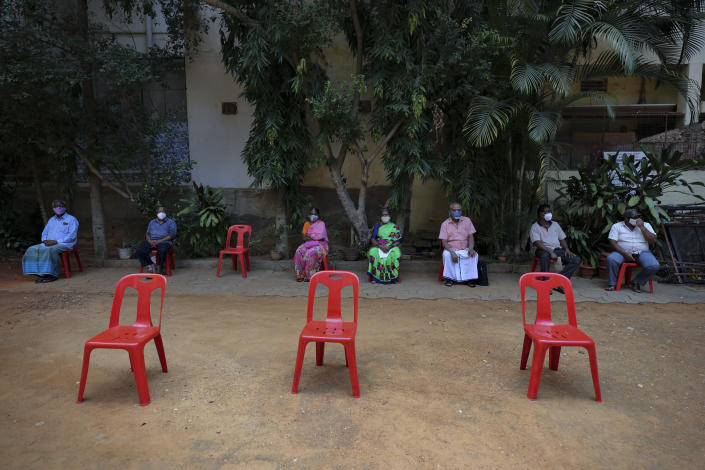 People who arrived early in the morning to get inoculated against the coronavirus wait their turn at a vaccination camp for those above age 45 being held in the premises of a school in Bengaluru, India, Wednesday, May 26, 2021. (AP Photo/Aijaz Rahi)