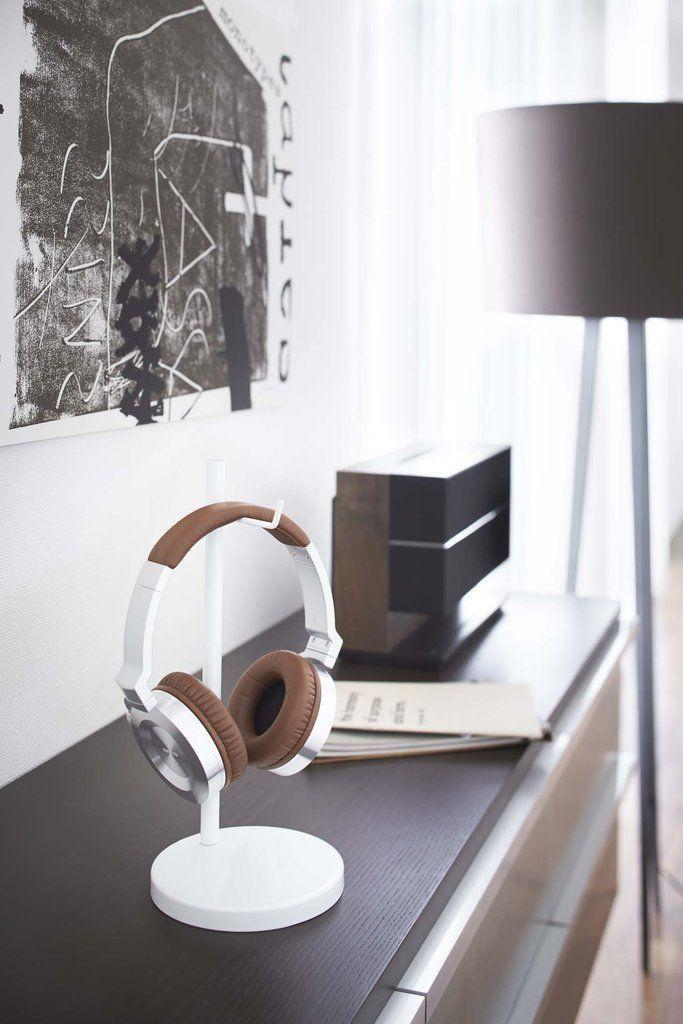 """<p><strong>Yamazaki</strong></p><p>Burke Decor</p><p><strong>$19.00</strong></p><p><a href=""""https://www.burkedecor.com/products/beautes-round-headphone-stand-in-various-colors-by-yamazaki"""" rel=""""nofollow noopener"""" target=""""_blank"""" data-ylk=""""slk:SHOP IT"""" class=""""link rapid-noclick-resp"""">SHOP IT</a></p><p>Alexa, play """"<a href=""""https://www.youtube.com/watch?v=5GL9JoH4Sws"""" rel=""""nofollow noopener"""" target=""""_blank"""" data-ylk=""""slk:Work from Home"""" class=""""link rapid-noclick-resp"""">Work from Home</a>."""" Instead of throwing your headphones on the couch after a long day, place them on this classic headphone stand, where you can easily grab them the next morning for your daily jam sessions. </p>"""