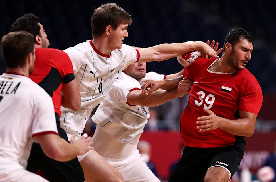 TOKYO, JAPAN - AUGUST 03: Yehia Elderaa of Team Egypt is under pressure from Finn Lemke and Paul Drux of Team Germany during the Men's Quarterfinal handball match between Germany and Egypt on day eleven of the Tokyo 2020 Olympic Games at Yoyogi National Stadium on August 03, 2021 in Tokyo, Japan. (Photo by Dean Mouhtaropoulos/Getty Images)