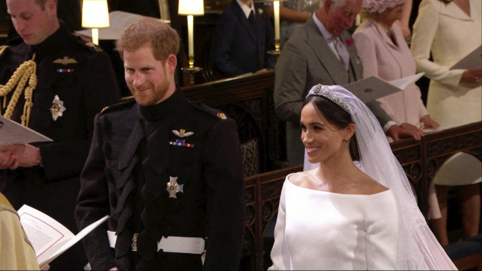 Prince Harry and Meghan Markle stand during their wedding ceremony at St. George's Chapel in Windsor Castle on Saturday. (Image: UK Pool/Sky News via AP)