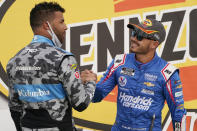 Bubba Wallace, left, congratulates Kyle Larson after Larson won a NASCAR Cup Series auto race Sunday, March 7, 2021, in Las Vegas. (AP Photo/John Locher)