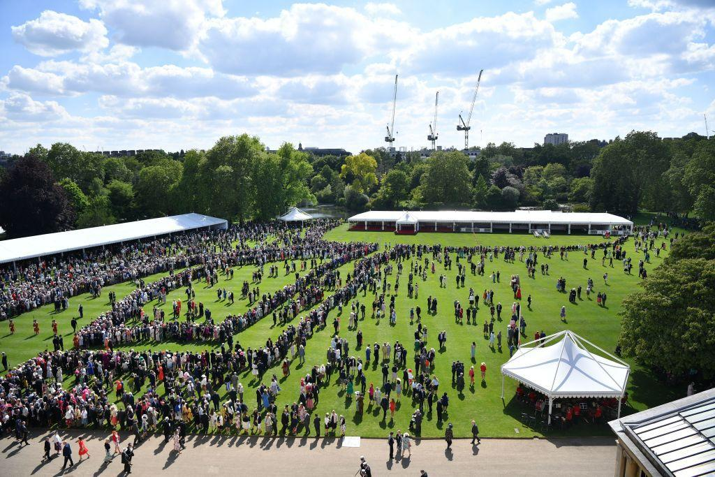 <p>Thousands of guests gather on the grounds of Buckingham Palace for the event. </p>