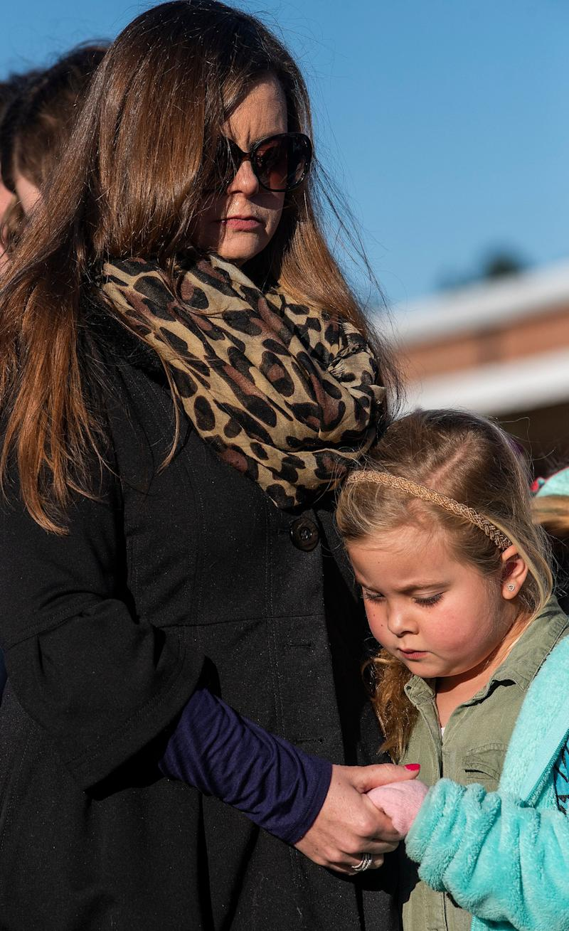 Students and community members gather for prayer at Lee Scott Academy in Auburn, Ala., on Tuesday March 5, 2019. A student from the school died during the fatal storm that struck Beauregard on Sunday afternoon.