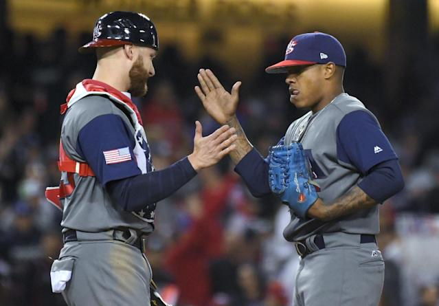 <p>U.S. catcher Jonathan Lucroy, left, greets pitcher Marcus Stroman in the sixth inning against Puerto Rico during the final of the World Baseball Classic. in Los Angeles, Wednesday, March 22, 2017. (AP Photo/Mark J. Terrill) </p>