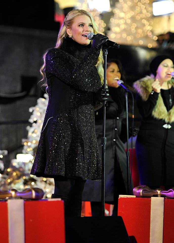 """Sporting a sparkling J. Mendel coat, Jessica Simpson serenaded a crowd of thousands (including her fiance Eric Johnson) at Rockefeller Center's annual tree lighting ceremony Tuesday night with a rendition of """"My Only Wish"""" before returning later in the evening to sing """"I'll Be Home for Christmas"""" with Persian Gulf vet John Britt. Kevin Mazur/<a href=""""http://www.wireimage.com"""" target=""""new"""">WireImage.com</a> - November 30, 2010"""