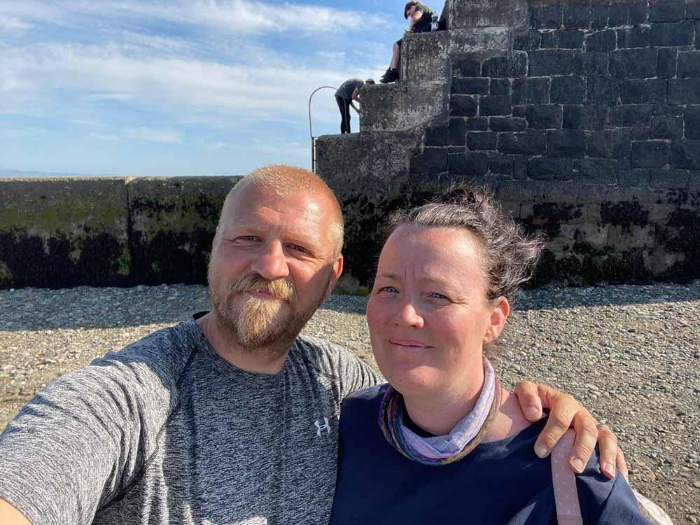 Jemma Falloon through the sore throat she was suffering from was long COVID, but it turned out to be cancer, pictured with husband Mark. (PA Real Life)