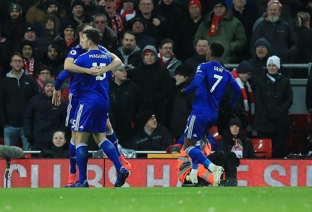 Harry Maguire, front left, celebrates scoring Leicester's equaliser at Anfield in January 2019
