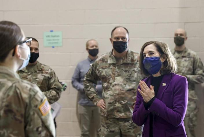 Oregon Gov. Kate Brown visits with National Guard members at a vaccination clinic in Salem earlier this year.