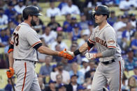 San Francisco Giants' Mike Yastrzemski, right, is met at home plate by Darin Ruf after Yastrzemski's solo home run during the first inning of the team's baseball game against the Los Angeles Dodgers on Wednesday, July 21, 2021, in Los Angeles. (AP Photo/Marcio Jose Sanchez)