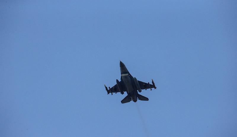 A missile-loaded Turkish Air Force warplane takes off from the Incirlik Air Base, on the outskirts of the city of Adana, southeastern Turkey, on July 28, 2015