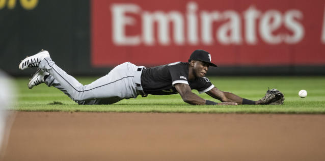 Chicago White Sox shortstop Tim Anderson dives for a ball hit by Seattle Mariners' Omar Narvaez during the fourth inning of a baseball game, Friday, Sept. 13, 2019, in Seattle. Narvaez was safe with a single. (AP Photo/Stephen Brashear)