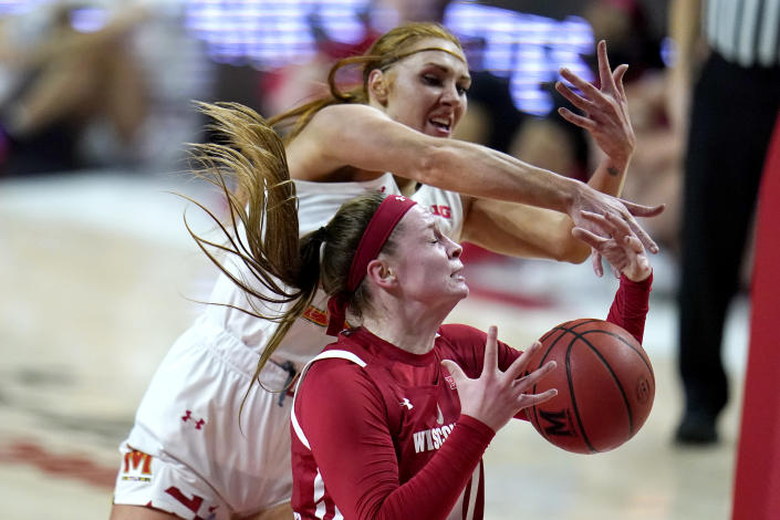 Wisconsin forward Tara Stauffacher, front, and Maryland forward Chloe Bibby compete for a rebound during the first half of an NCAA college basketball game, Thursday, Feb. 4, 2021, in College Park, Md. (AP Photo/Julio Cortez)