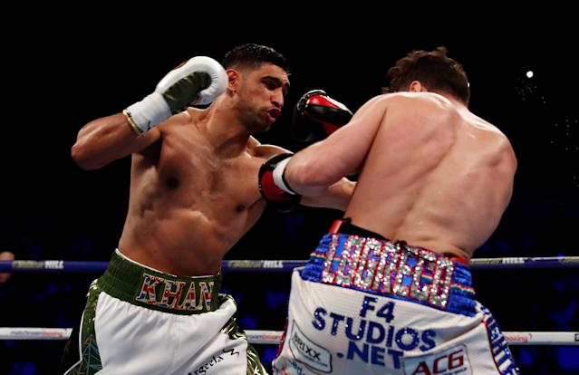 Boxing - Amir Khan v Phil Lo Greco - Echo Arena, Liverpool, Britain - April 21, 2018 Amir Khan in action with Phil Lo Greco Action Images via Reuters/Andrew Couldridge