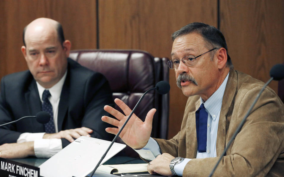 FILE - In this Nov. 9, 2015, file photo, Arizona state Rep. Mark Finchem, R-Tucson, right, speaks during a Joint Border Security Advisory Committee at the Arizona Capitol as Arizona House Speaker David Gowan, R- Sierra Vista, listens in Phoenix. Lawmakers from at least a half-dozen states attended or observed the massive demonstrations in Washington that turned into a violent assault on the U.S. Capitol. Arizona state Rep. Mark Finchem posted photos of himself attending the protest outside the Capitol, but his office said he observed from afar. Liberal groups in the state want him expelled for backing the effort to overturn the election. (AP Photo/Ross D. Franklin, File)