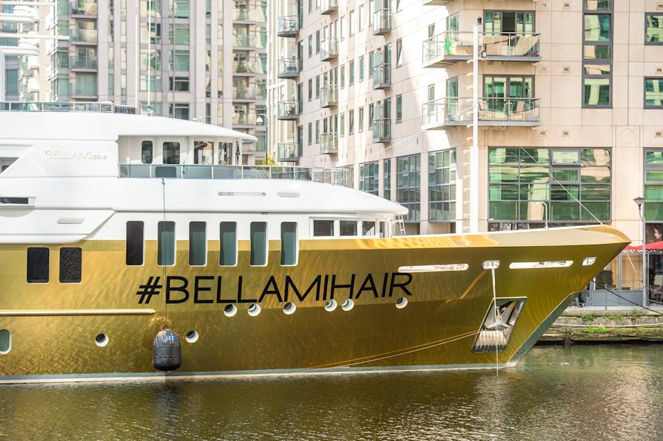 Wowza! The shining vessel named Bellami is covered in yards of gold vinyl wrap and is currently being patched up.  (SWNS)