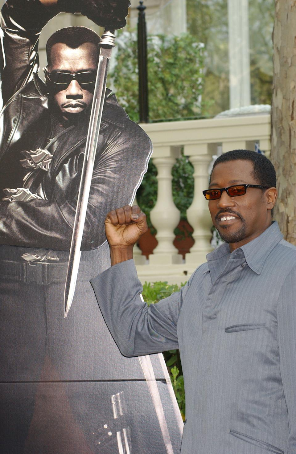404056 04: Actor Wesley Snipes poses for photographers while promoting his new movie