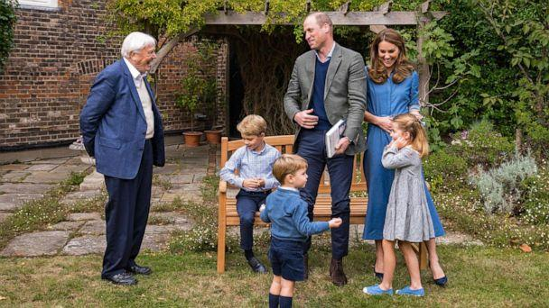 PHOTO: Prince William, Catherine, Duchess of Cambridge, Prince George, Princess Charlotte and Prince Louis with Sir David Attenborough in the gardens of Kensington Palace in London. (Kensington Palace/AFP via Getty )