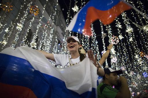 Russian soccer fans celebrate the national team victory after the group A match between Russia and Egypt during the 2018 soccer World Cup in Moscow, Russia, early Wednesday, June 20, 2018. (AP Photo/Alexander Zemlianichenko)