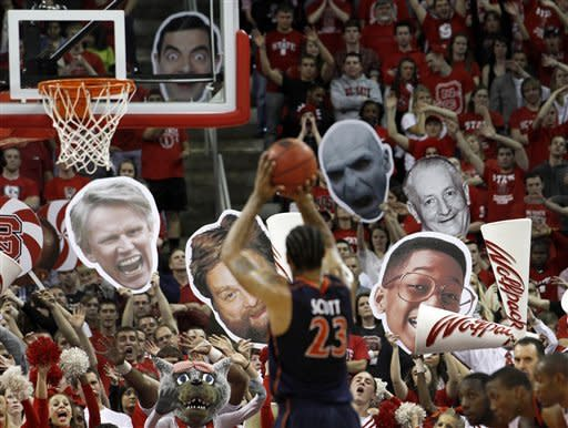 Virginia forward Mike Scott (23) shoots a foul shot during the second half of an NCAA college basketball game against North Carolina State in Raleigh, N.C., Saturday, Jan. 28, 2012. Virginia won 61-60. (AP Photo/Jim R. Bounds)