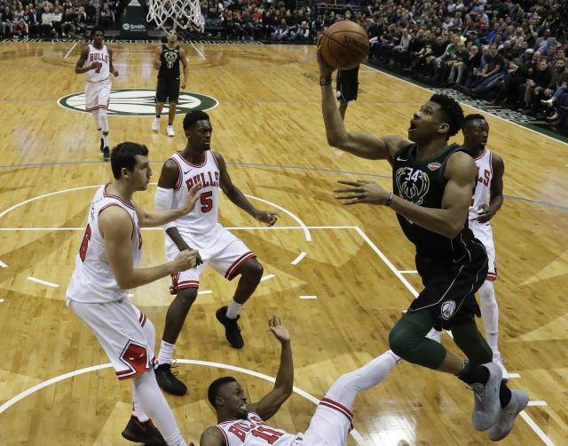 "<a class=""link rapid-noclick-resp"" href=""/nba/players/5185/"" data-ylk=""slk:Giannis Antetokounmpo"">Giannis Antetokounmpo</a> went first overall during a recent midseason fantasy hoops draft (AP Photo)."