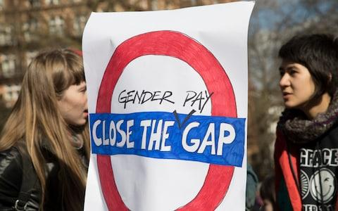 Women protest against the pay gap in London - Credit: Mike Kemp