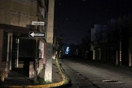 A general view shows a street after Puerto Rico Electric Power Authority (PREPA), the island's power company, said on Wednesday that a major power line failure in southern Puerto Rico cut electricity to almost all customers, in San Juan, Puerto Rico April 18, 2018. REUTERS/Gabriel Lopez Albarran